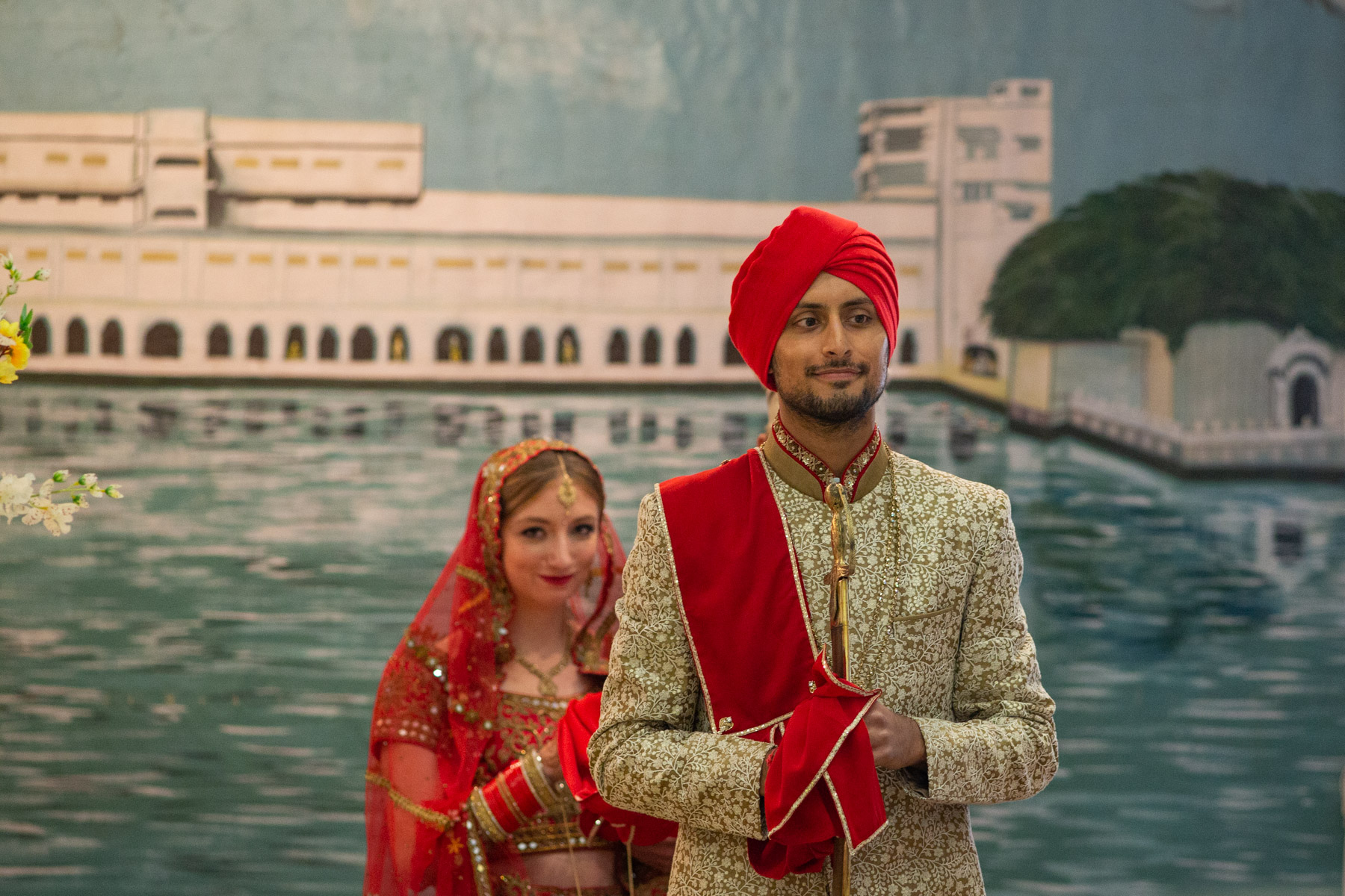 Sikh wedding ceremony with bride and groom