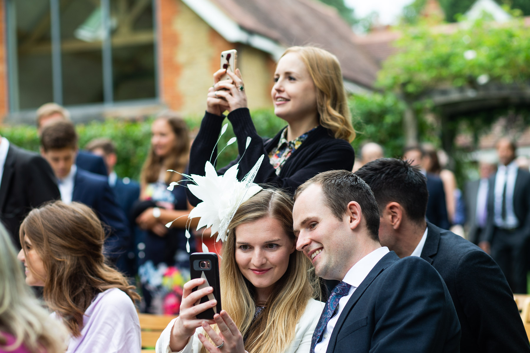 Guest taking a photo at wedding ceremony