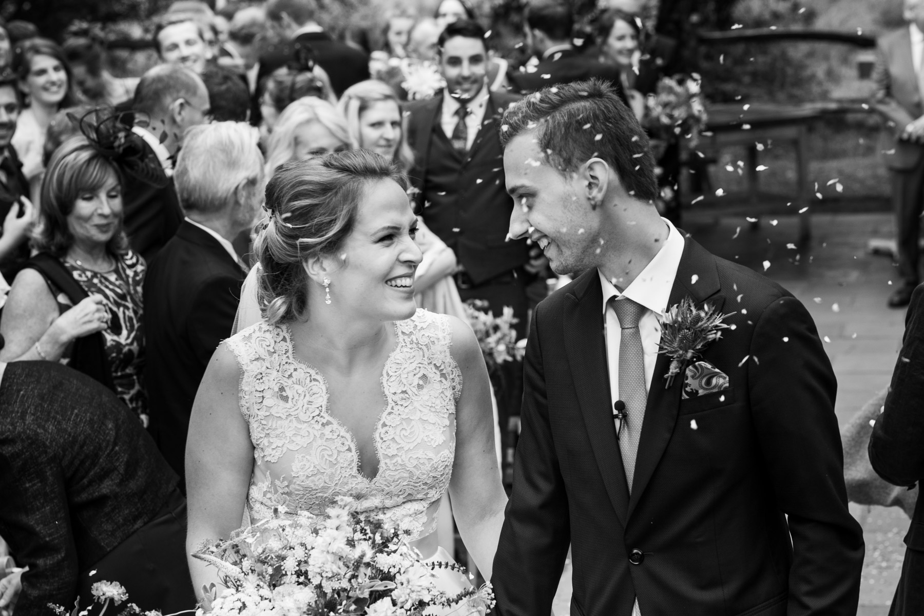 Relaxed confetti photo of bride and groom