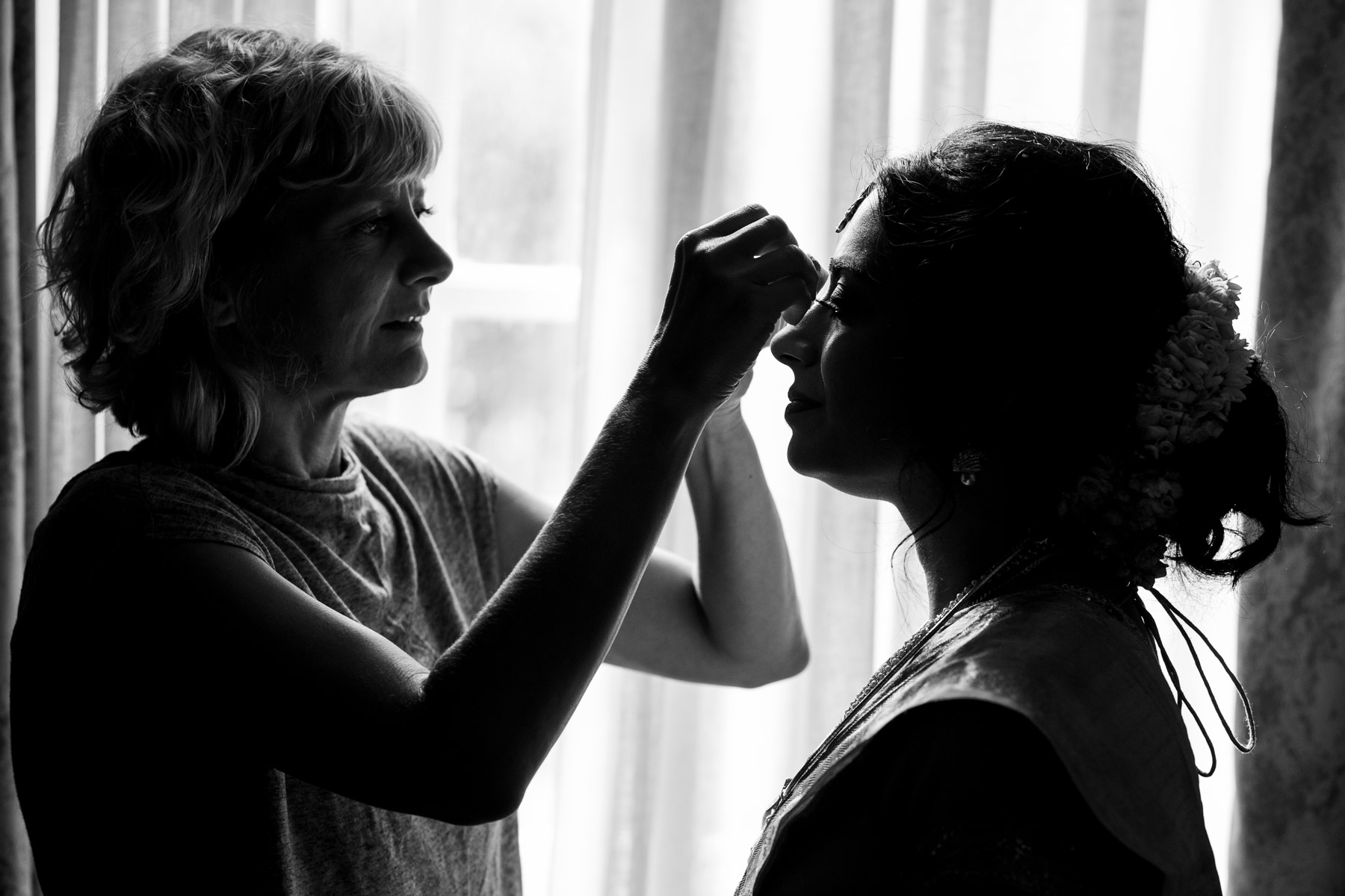 Romantic and creative photo of bride getting ready