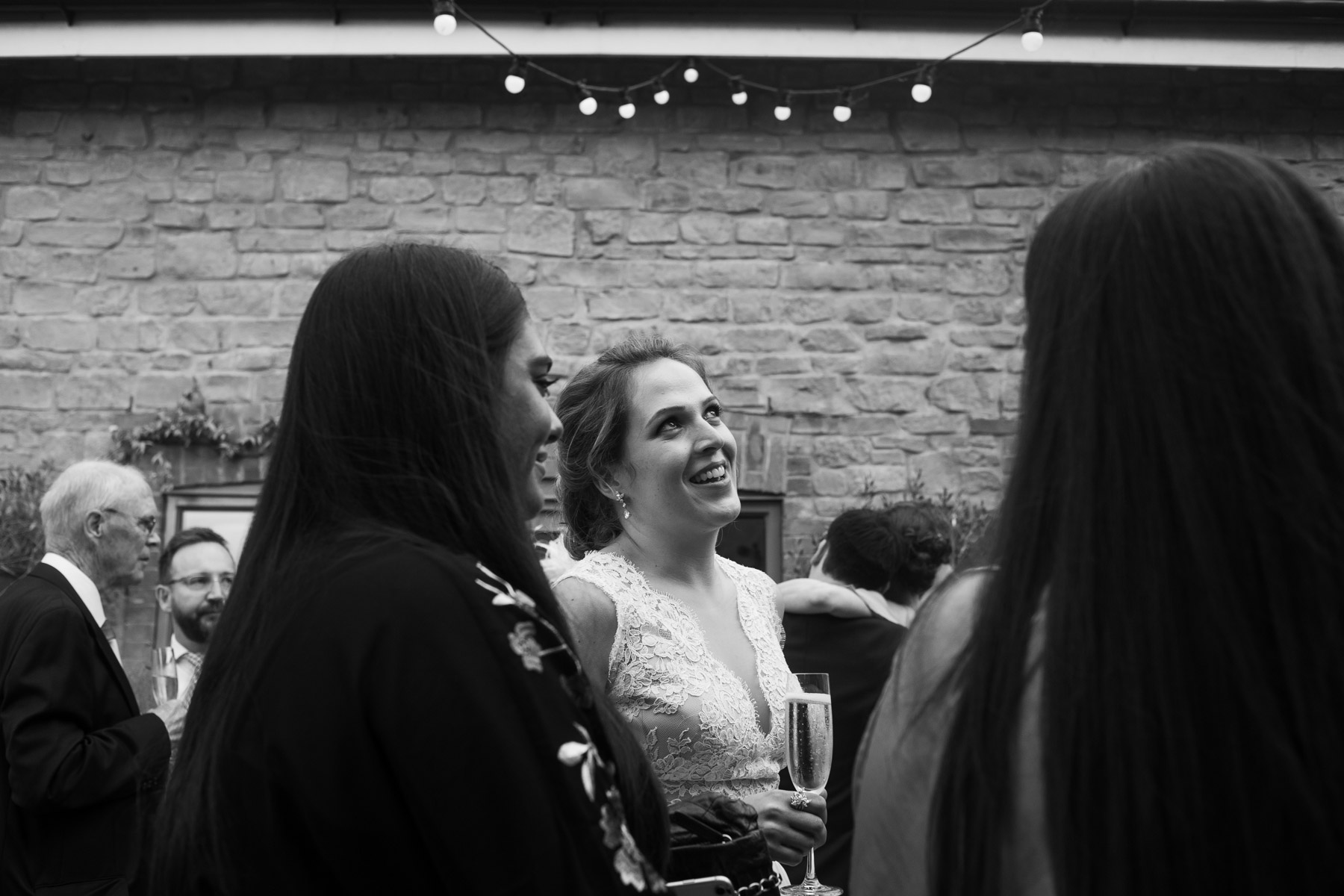 Relaxed and fun photo of bride and guests