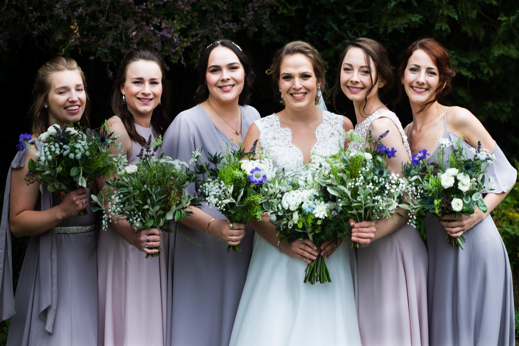 Relax photo of wedding bride with her bridesmaids