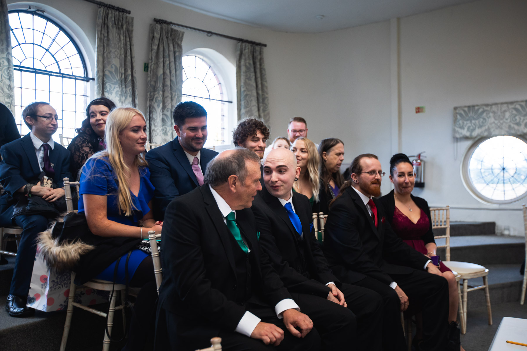 Wedding guests with groom