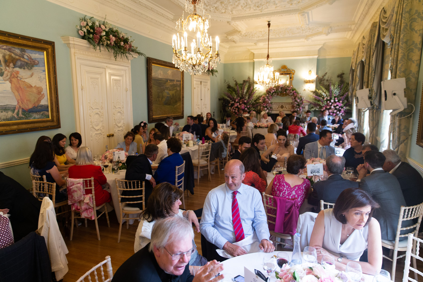 Wedding guests sitting down for relaxed meal
