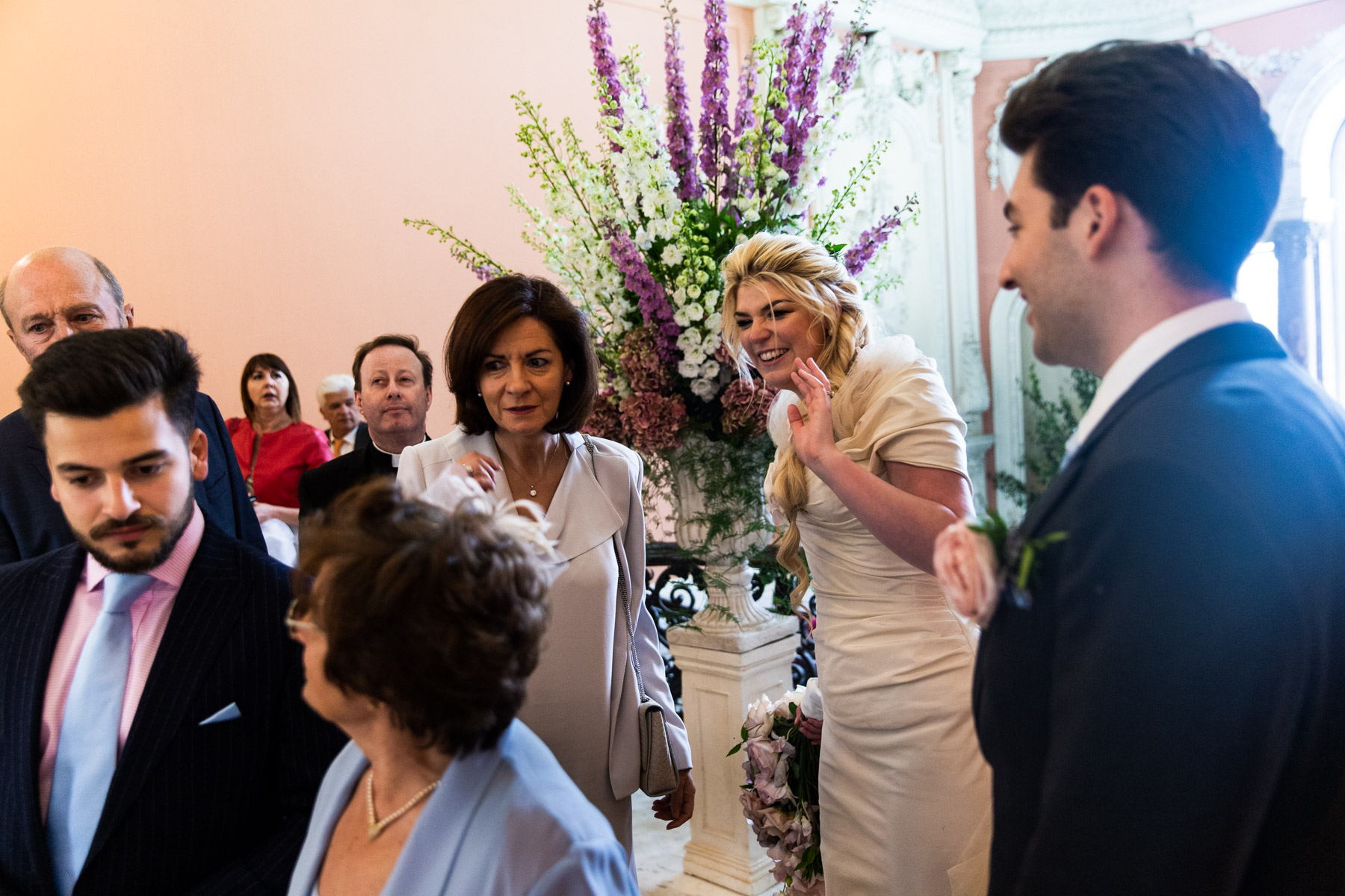 Relaxed bride and groom greeting guests