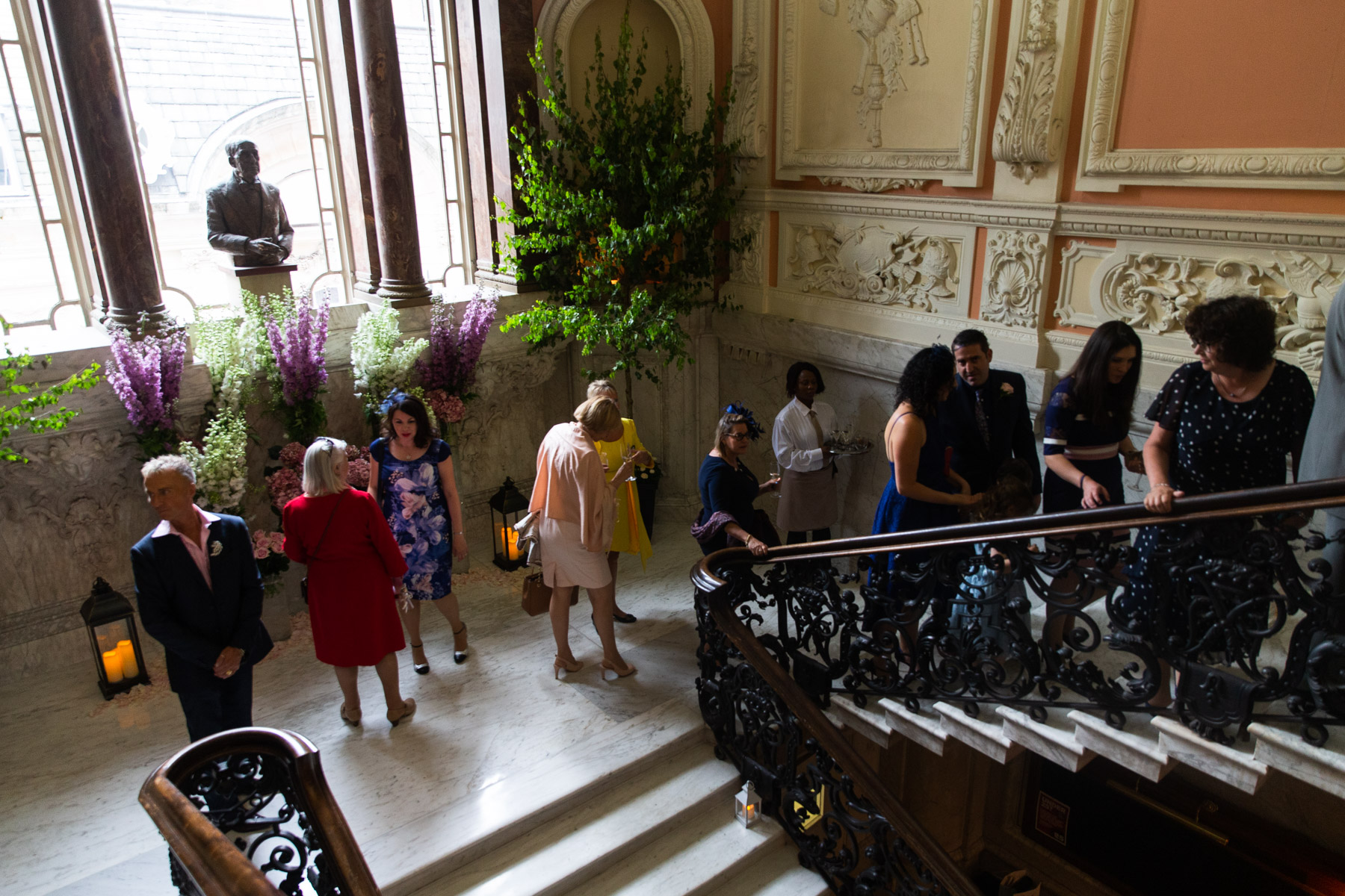 Guests walking upstairs to wedding reception