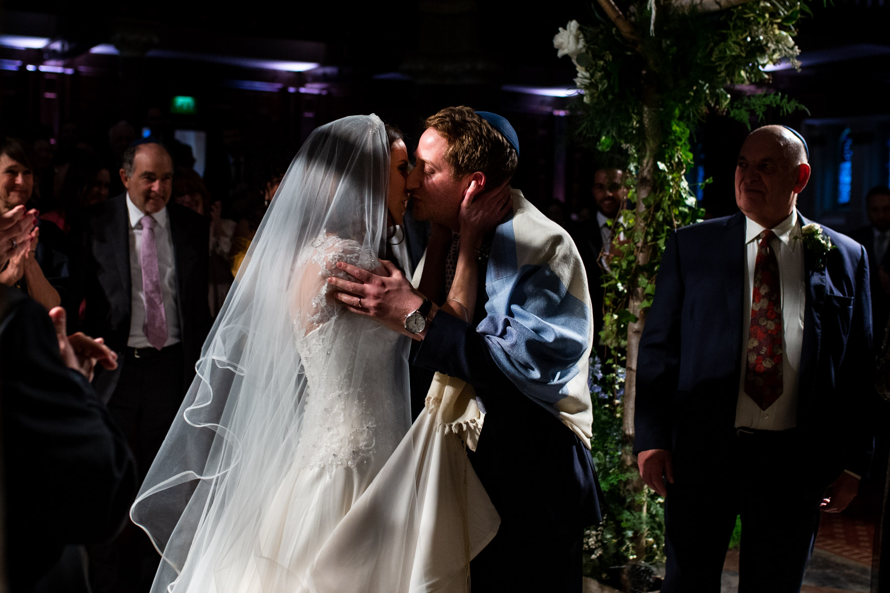 Romantic photo of bride and groom first kiss