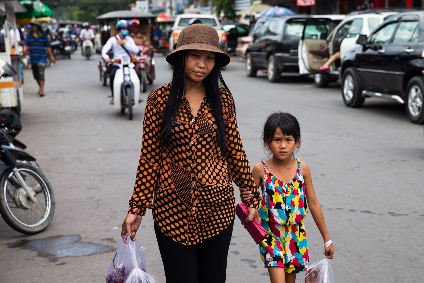 Mother and child walking down road