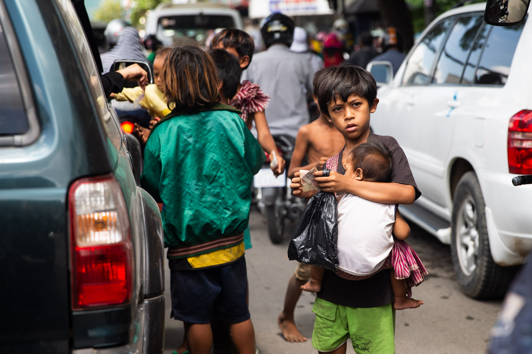 Young children begging on road
