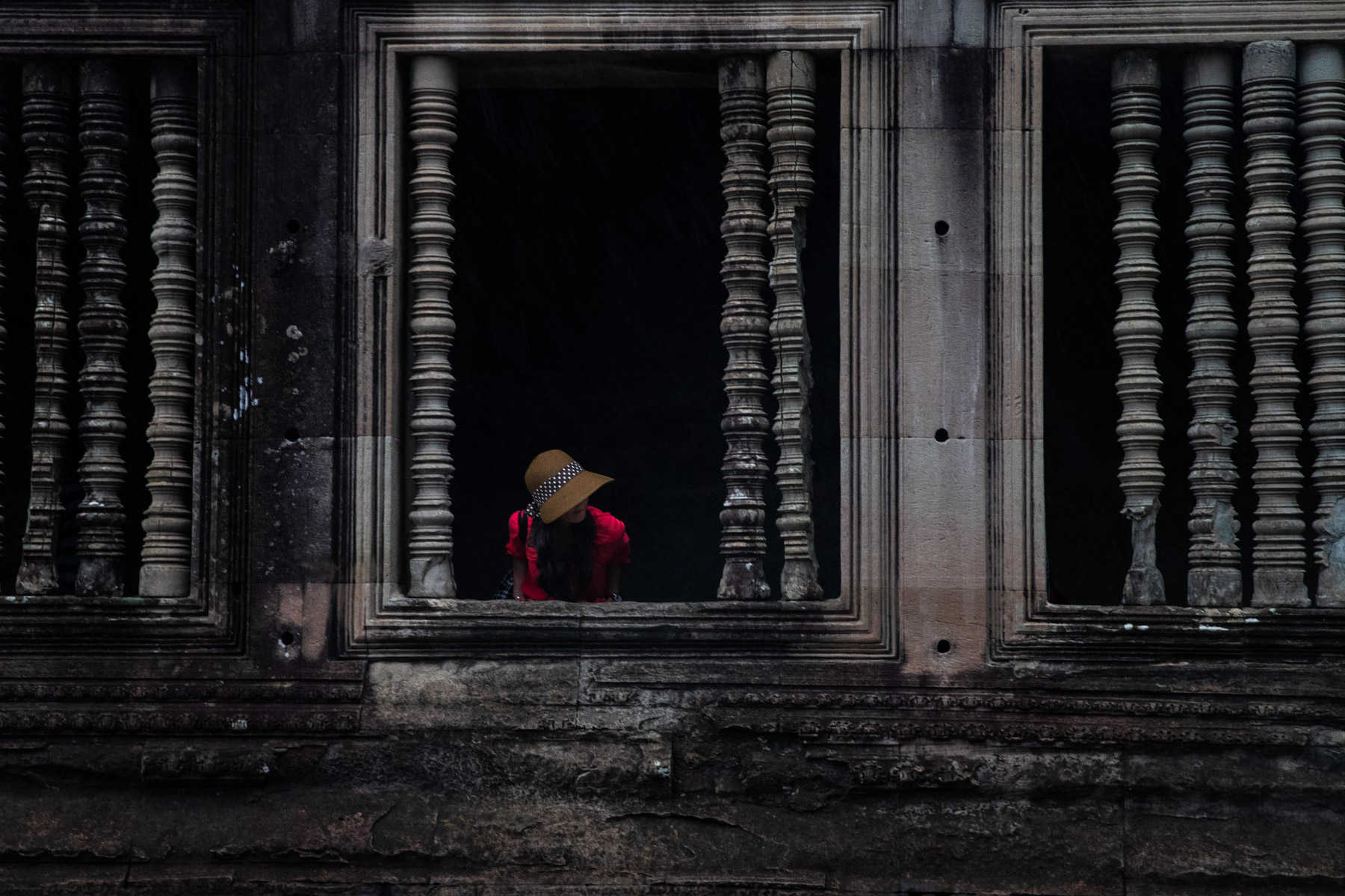 Girl in red dress in temple
