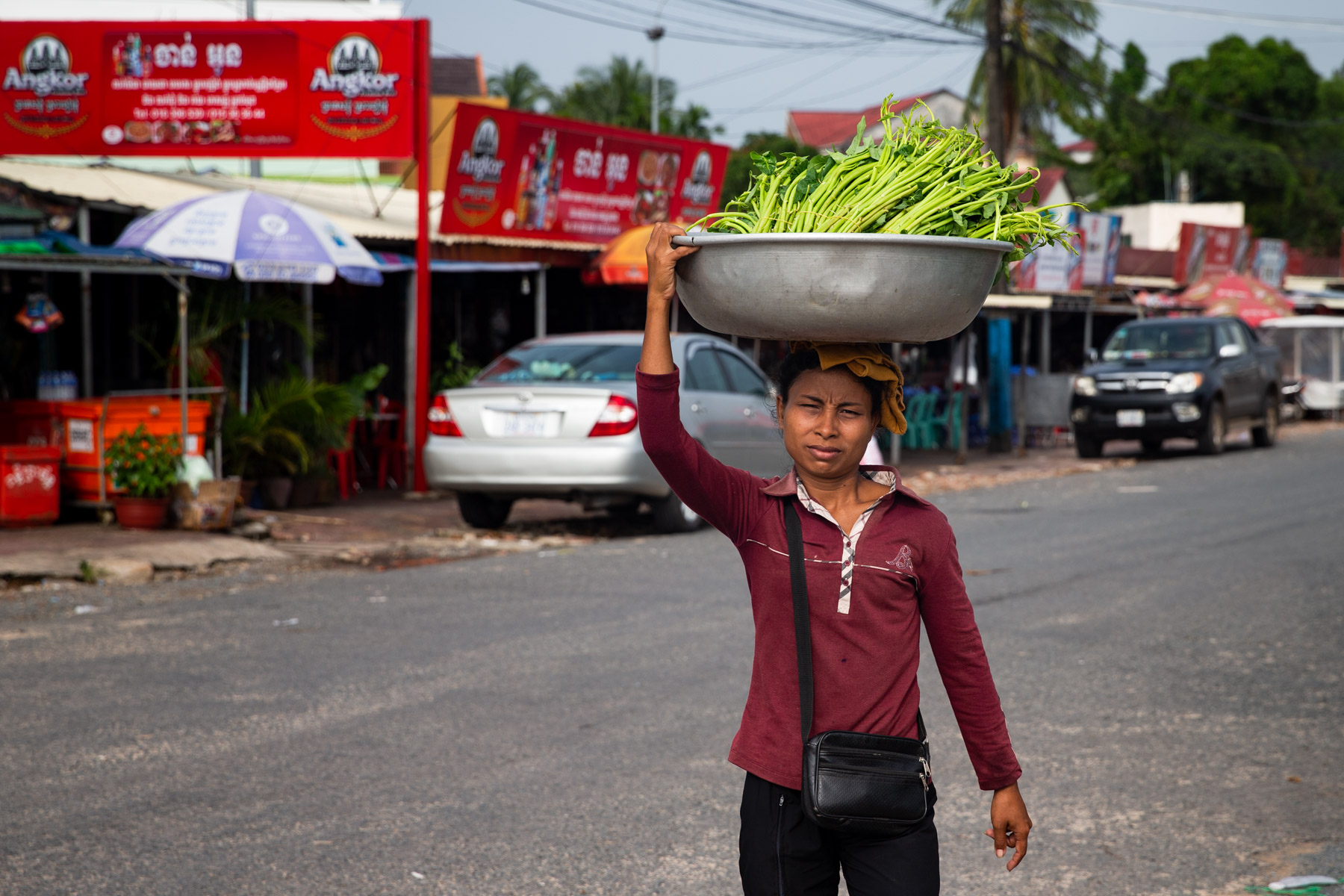 Local woman with a pot of food on the head