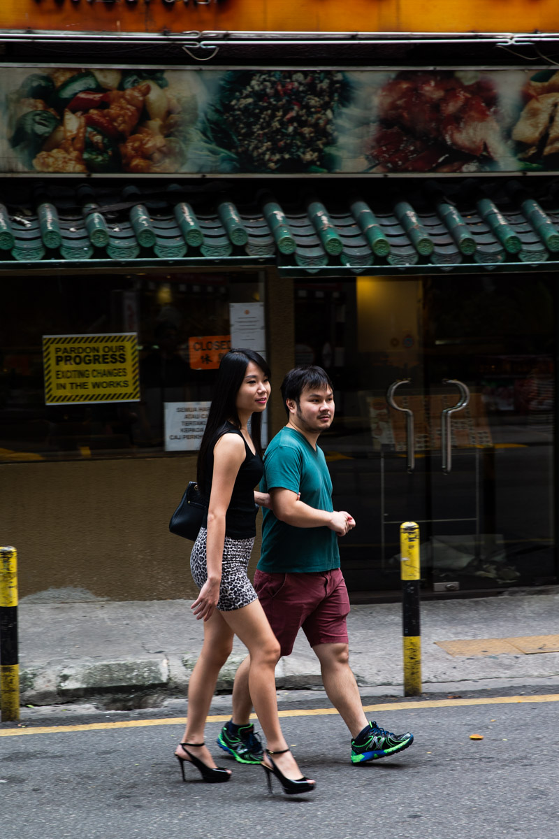 Couple walking down the road