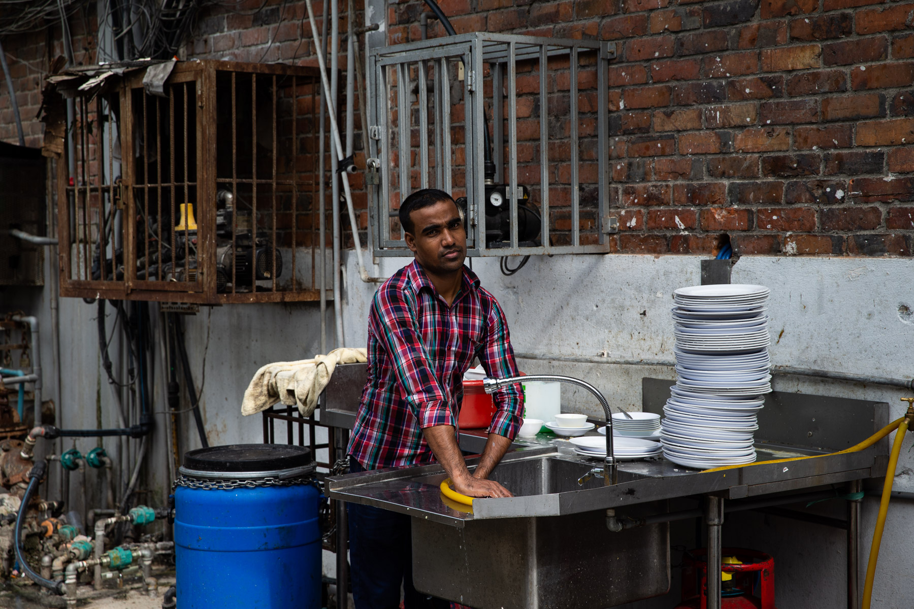 Person washing up in Street