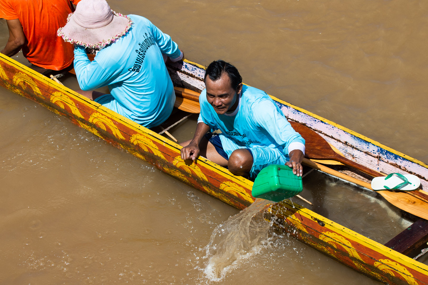man emptying boat of water