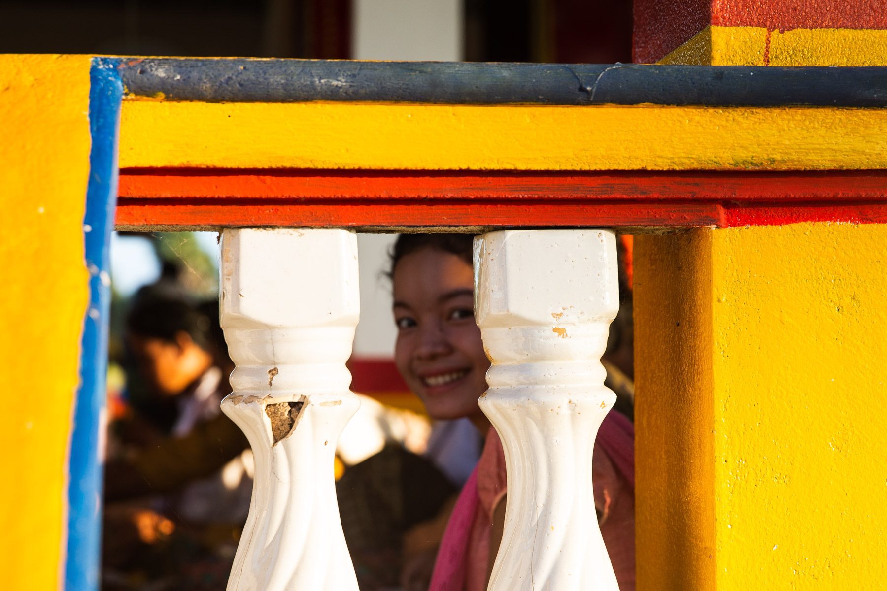 Young women smiling through temple