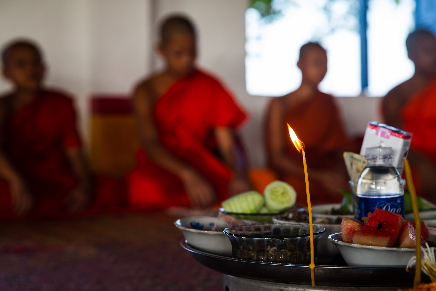 Photo of candle and monks
