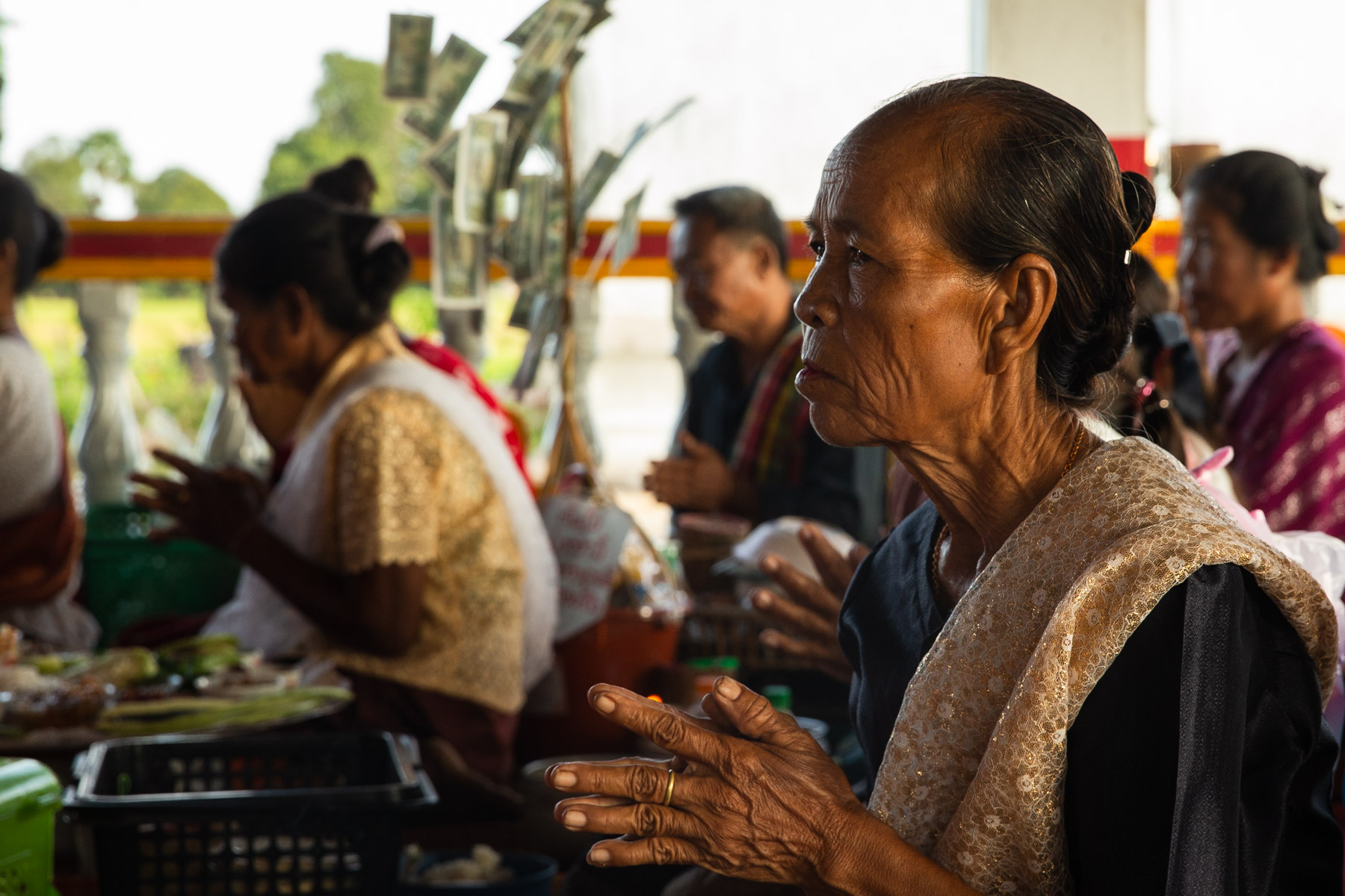 Photo of old women in temple ceremony
