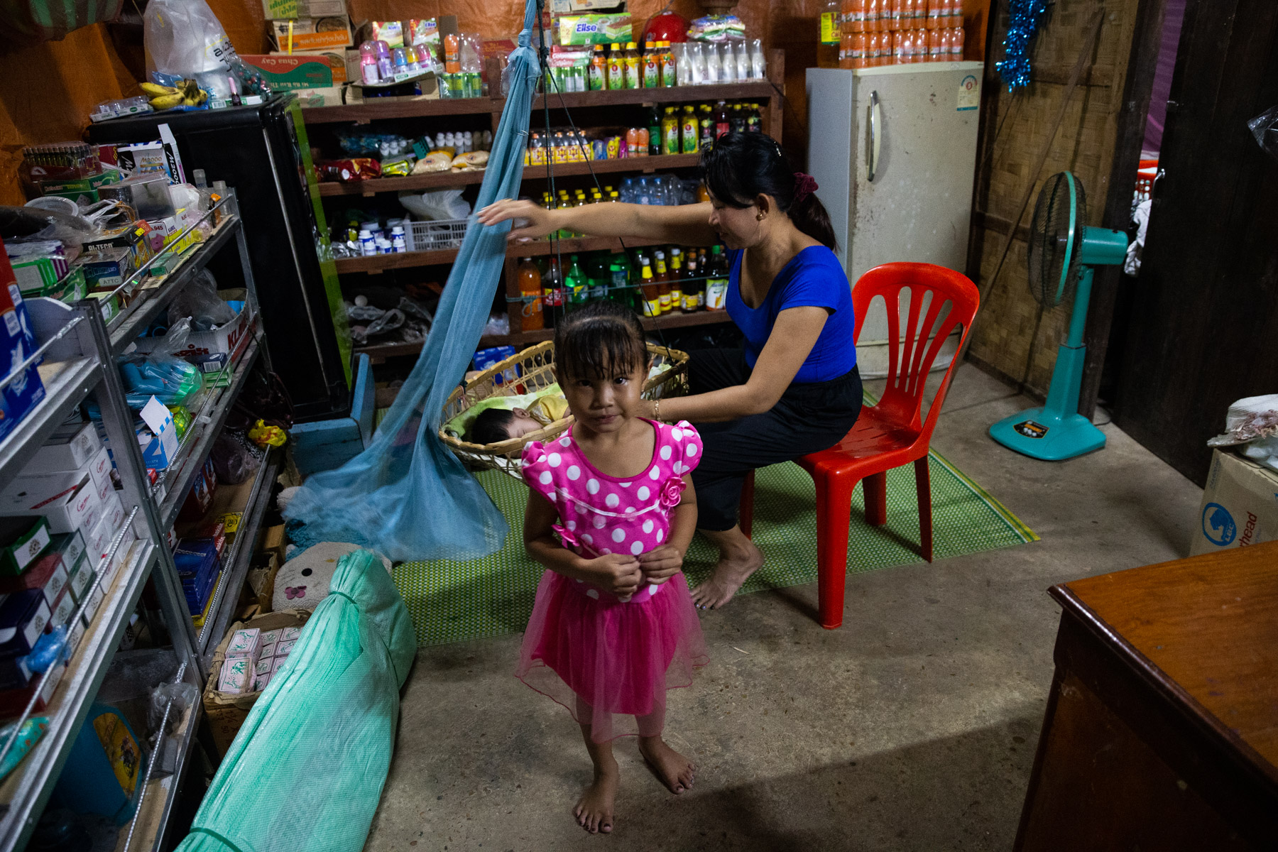 Local shop with young girl and mum