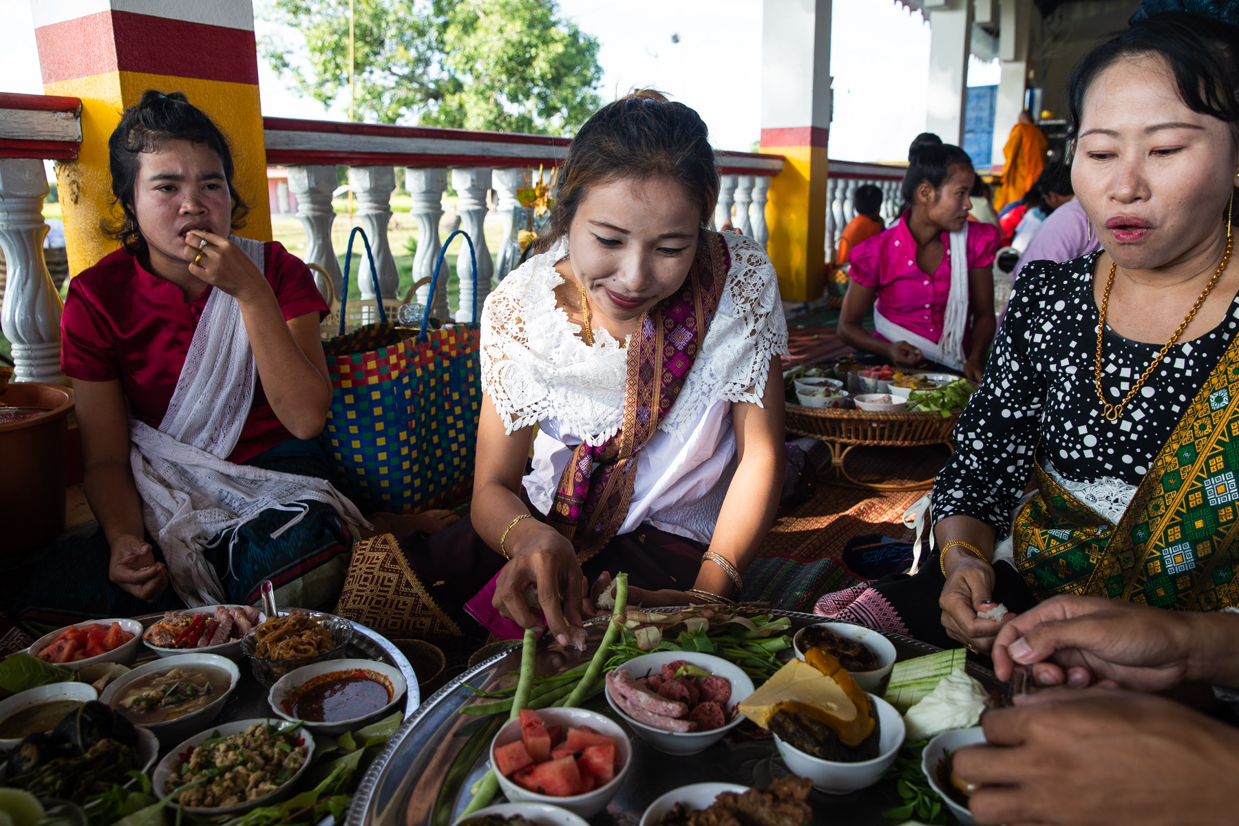 Women eating food at ceremony