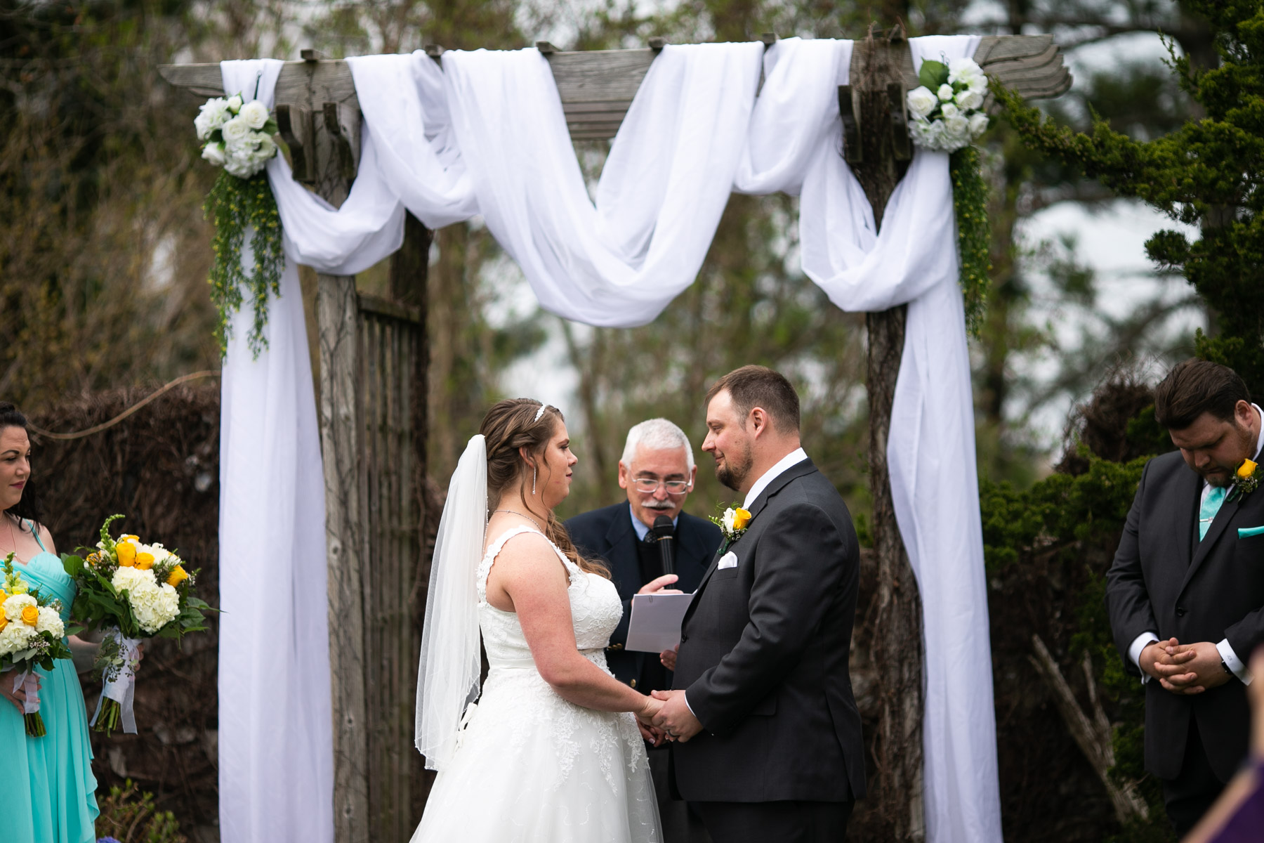 Romantic bride and groom giving vowels