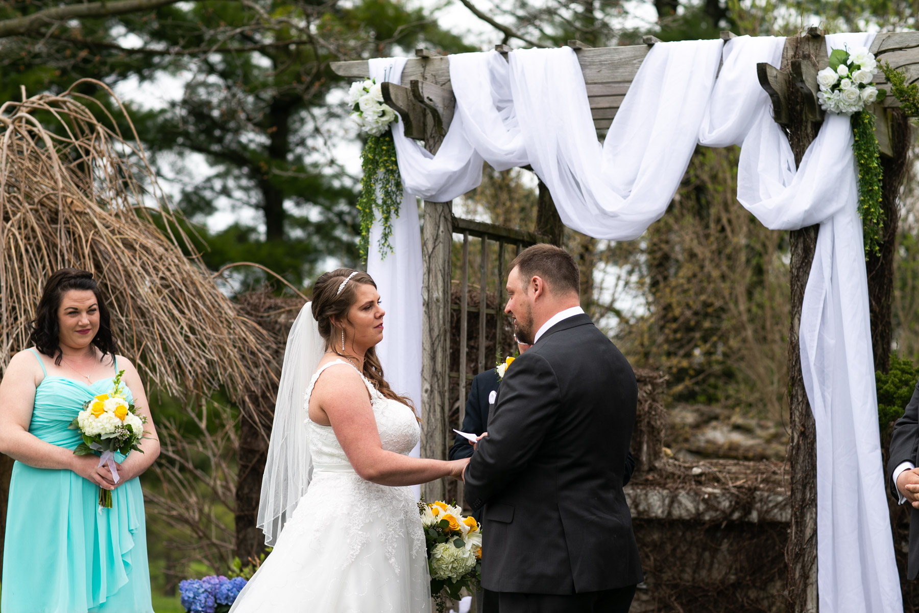 Intimate moment of bride and groom at outdoor wedding ceremony