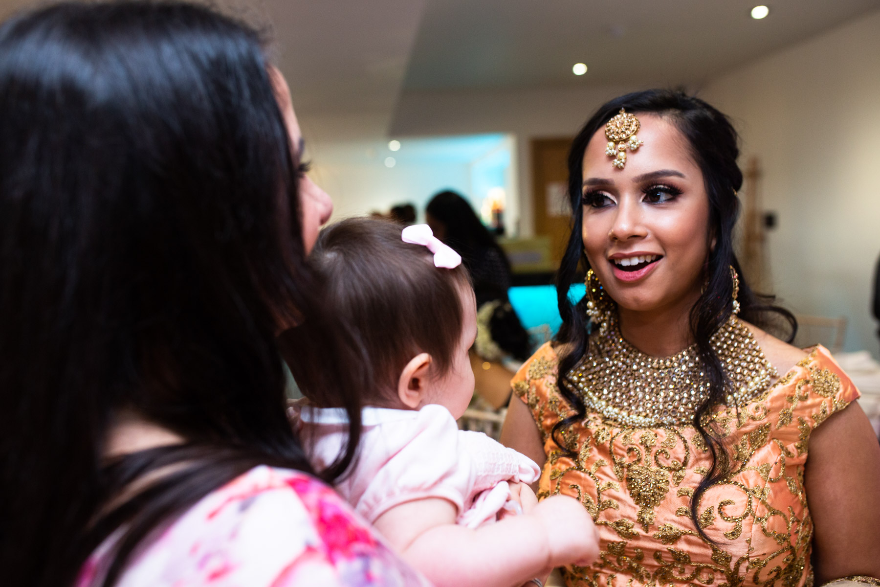 Bride smiling at wedding guest
