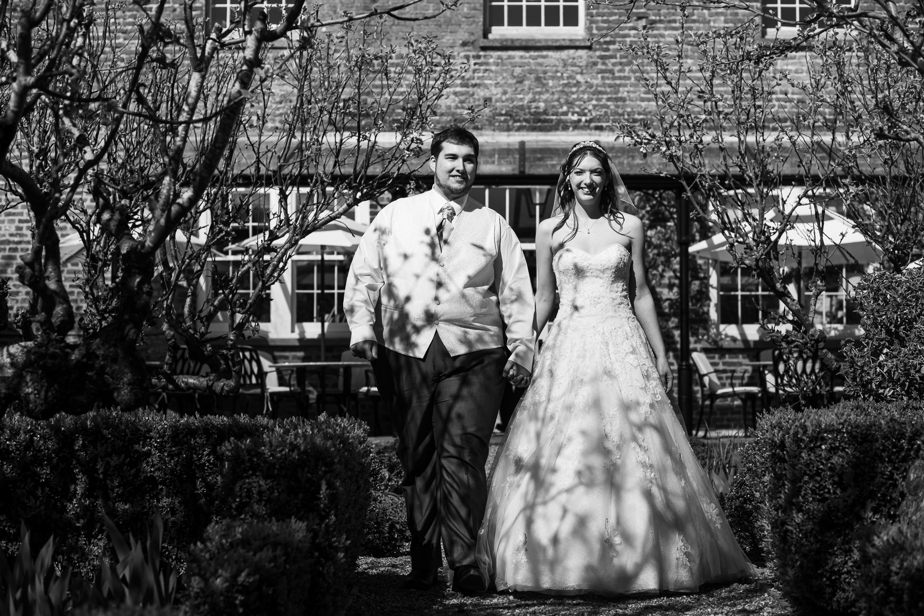Black and white photo of bride and groom arriving