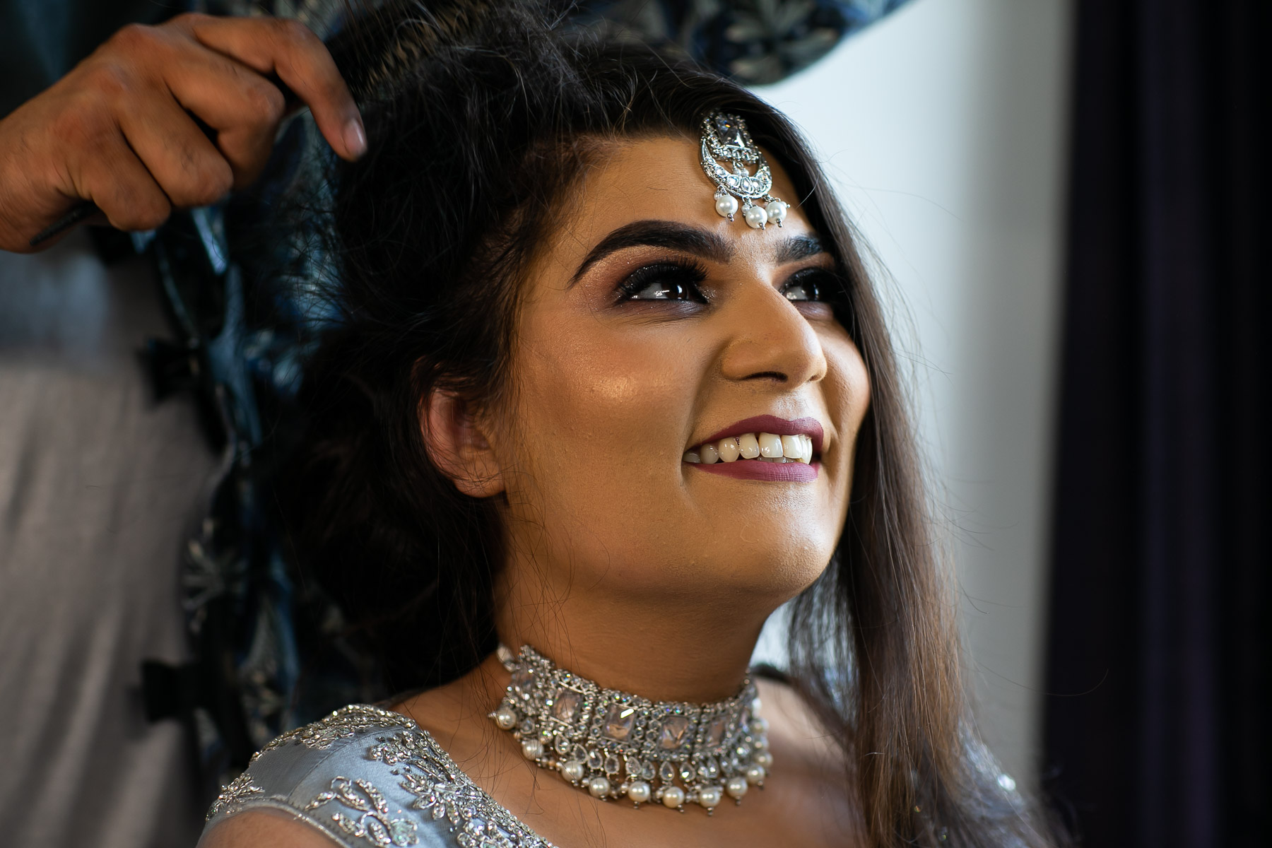 Stunning bride getting ready for her wedding day