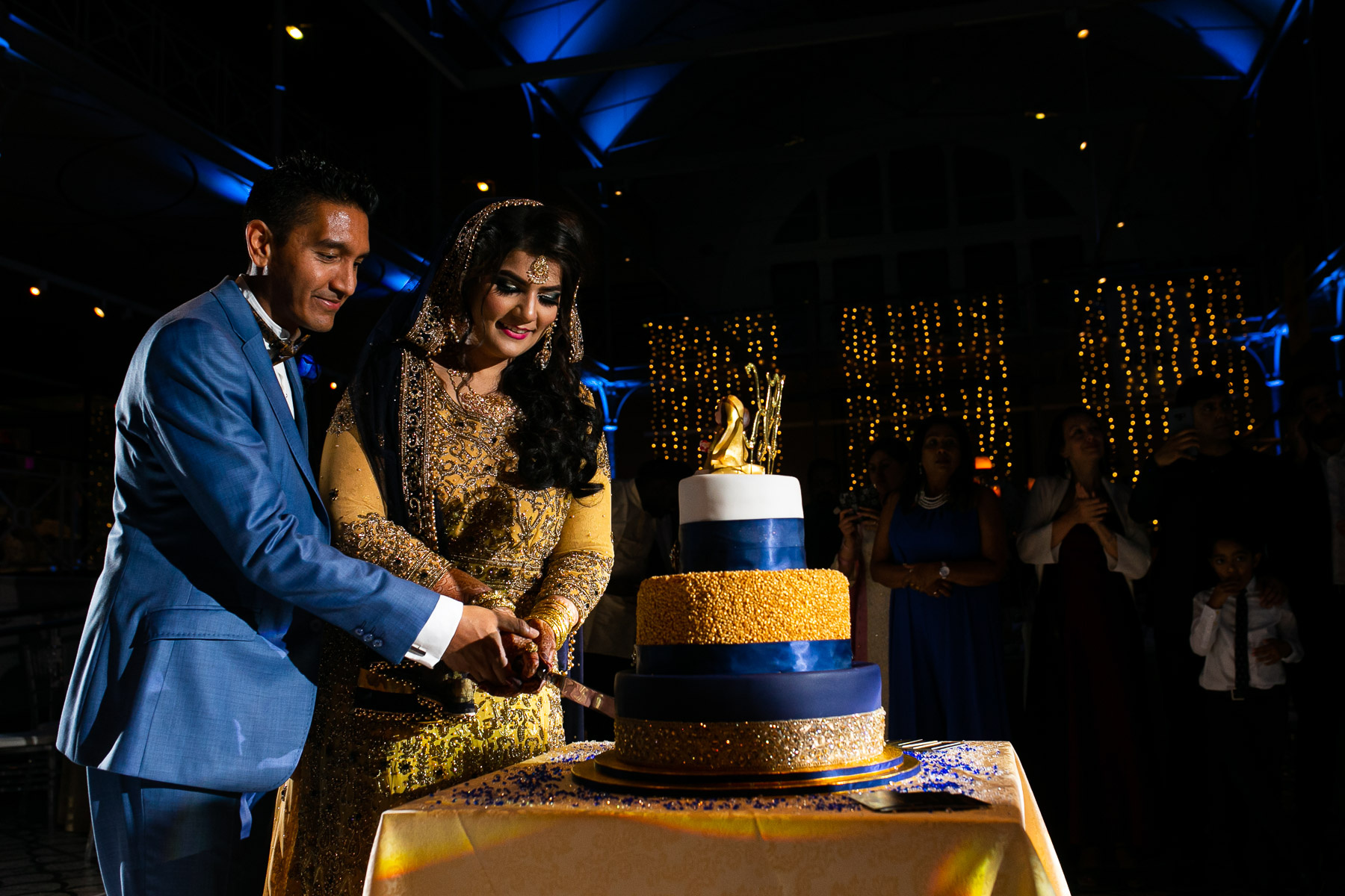 Relaxed bride and groom cutting cake