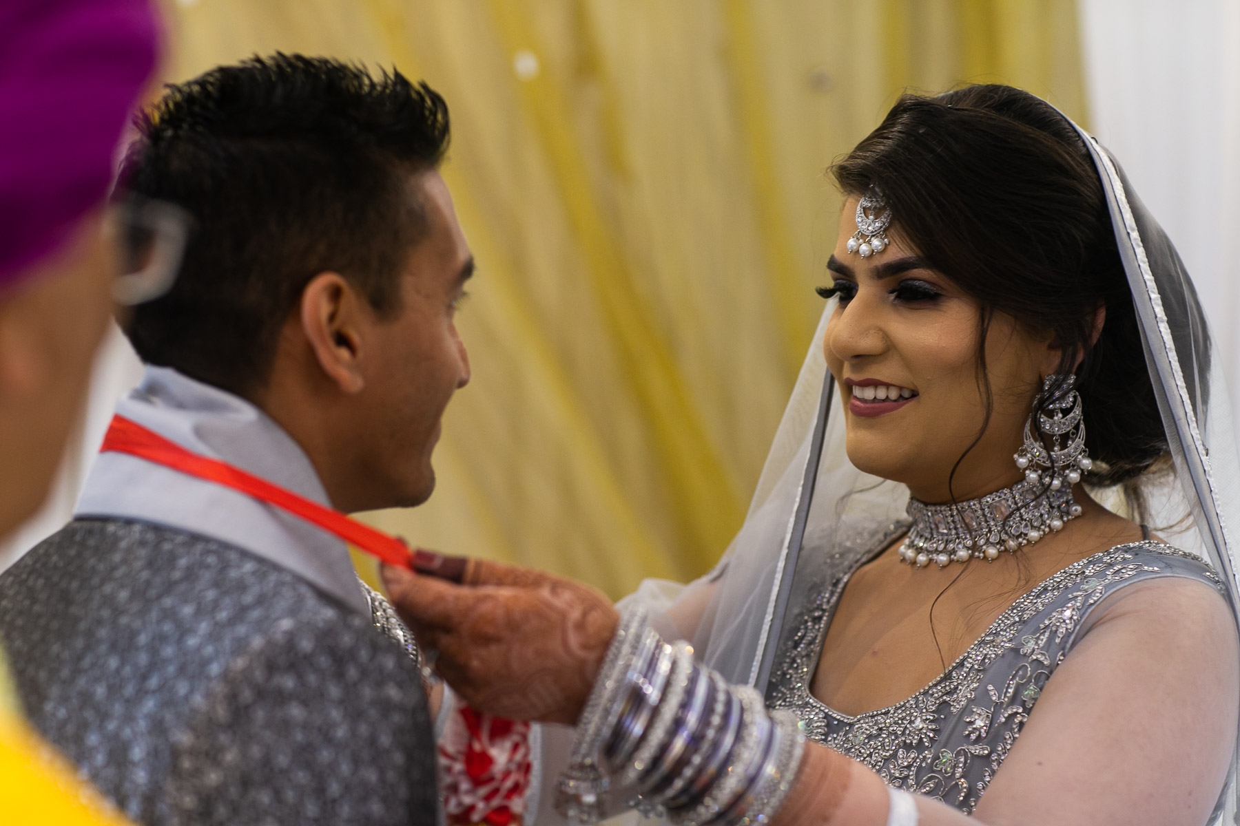 Bride smiling at groom at relaxed wedding ceremony