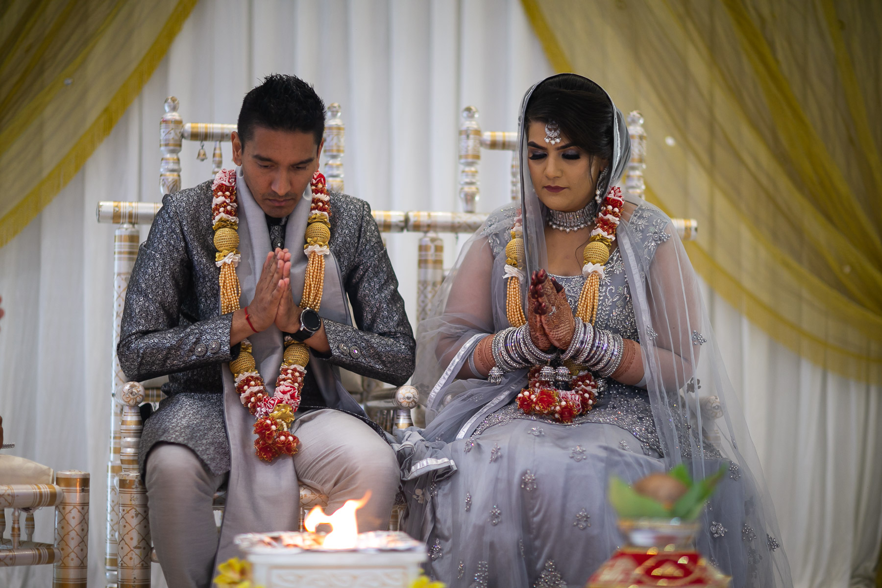 Bride and groom at Asian wedding ceremony