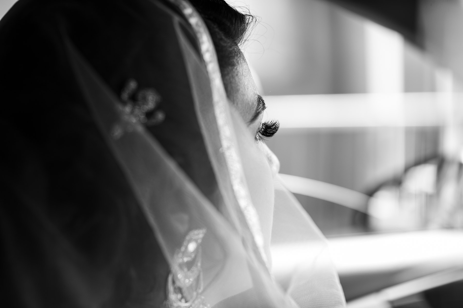Asian bride on her way to wedding ceremony in the car