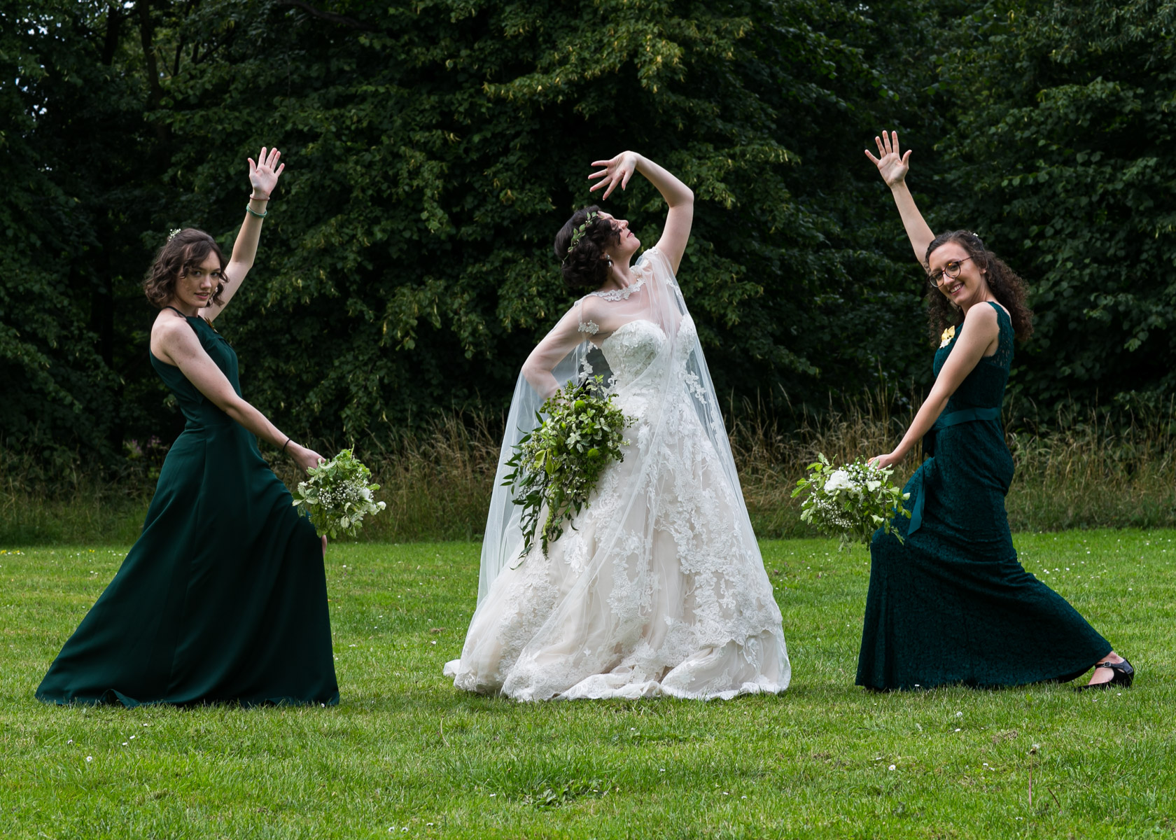 Relaxed bride and bridesmaids posing